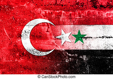Syria and Turkey Flag painted on grunge wall