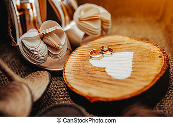 Shoes and rings - Shous and rings of bride on wooden heart