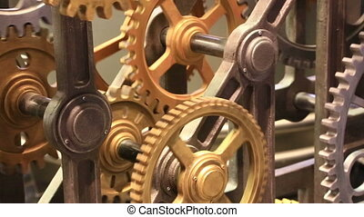 Moving gears of old mechanism close up - Mechanical...
