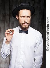 Cheerful young man with beard and cigar - Handsome bearded...