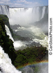Iguazu Falls, at the border of Argentine and Brasil,...