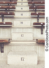 Stairs on the bleachers at a arena with numbers 12-18....