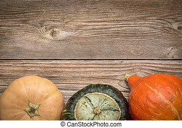 rustic wood background with winter squash - rustic weathered...