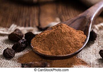 Cola Nut Powder(close-up shot) on vintage wooden background