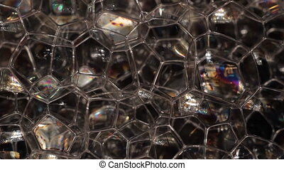 Foam bubbles abstract black background Full HD