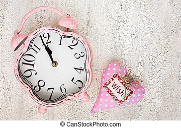 Retro pink clock and soft pink heart with word WISH on...