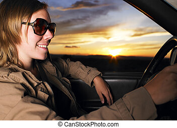 Young Woman Wearing Sunglasses Smiling and Driving - Young...