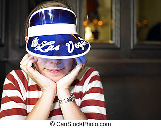 Young Woman with Blue Visor Smiling - Young woman wearing...