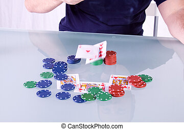 Man Throwing Cards on the Table in Texas Hold\'em - Royal...