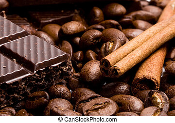 chocolate, coffee and cinnamon sticks - arrangement of...