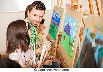 Art teacher talking to a student - Good looking young...