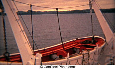 1974: Lifeboats at sunset on - 100% unique vintage 8mm film...