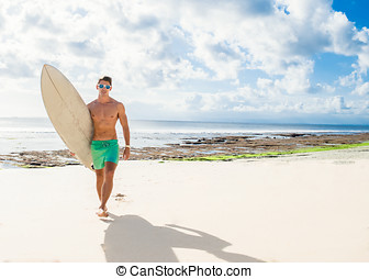 professional surfer holding a surf board man