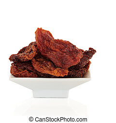 Sun Dried Tomatoes - Sun dried tomatoes in a white porcelain...