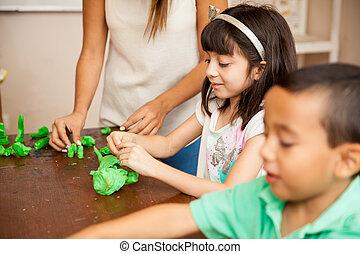 Kids and teacher in a sculpting class