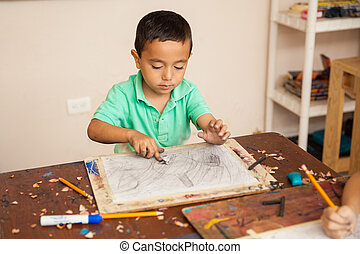 Boy enjoying his art class at school