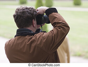 Photographer take photos in the park
