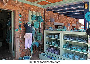 Beautiful souvenir shop with turquoise greek gifts, Greece