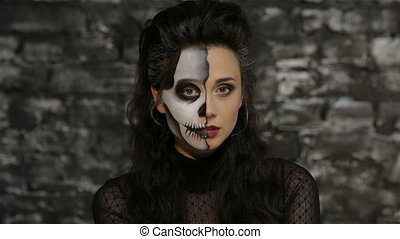 Woman blowing a kiss. Beautiful woman with make-up skeleton...