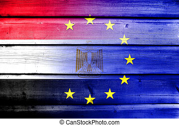 European Union and Egypt Flag on wood background