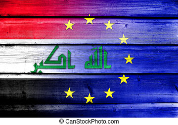 European Union and Iraq Flag on wood background