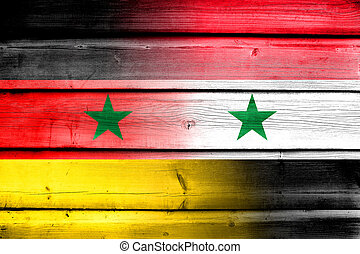 Syria and Germany Flag on wood background