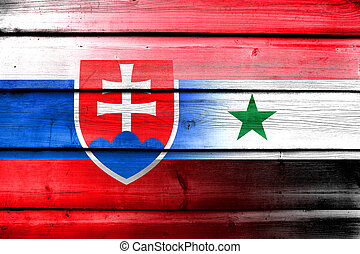 Syria and Slovakia Flag on wood background