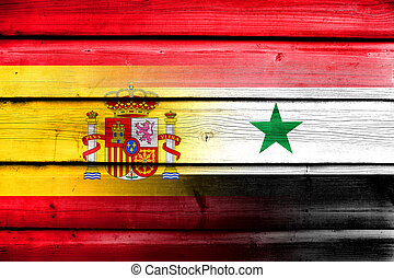 Syria and Spain Flag on wood background