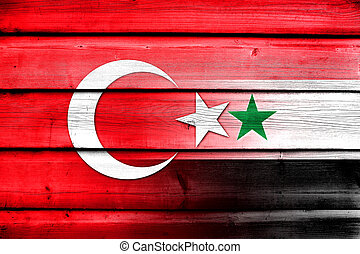 Syria and Turkey Flag on wood background