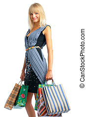 Smiling shoping woman with parsels on white background