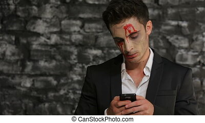Male vampire uses a smartphone Man in the image of the...