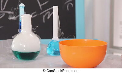 Chemistry Class - Chemistry teacher puts dry ice into the...