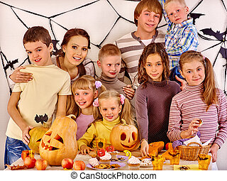 Family with child holding make carved pumpkin - Family on...