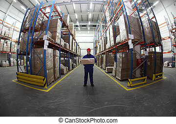 worker with box - worker in blue uniform with box in the...