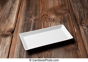 White plate on a wooden table