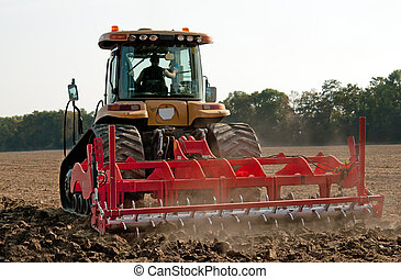 cultivator - farmer in tractor preparing land with seedbed...