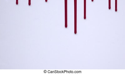 blood flowing vertically on a white - blood draws vertical...
