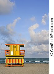 Miami Beach lifeguard colorful houses over blue sky