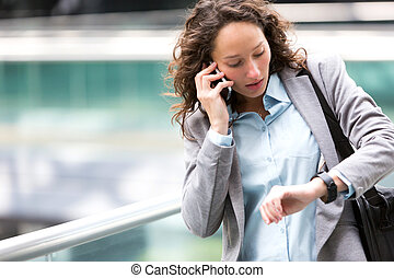 Young attractive woman being late to a rendez-vous - View of...