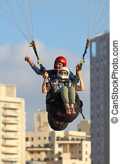 paragliding - A man and woman paragliding