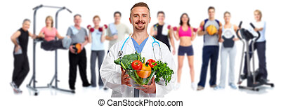 Doctor with vegetables and group of fitness people.