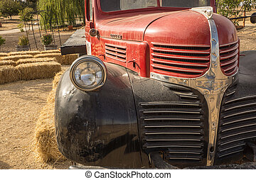 Old Farm Truck - A vintage flat-bed truck rests at a country...