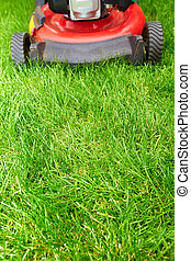 Lawn mower. - Lawn mower cutting green grass in...