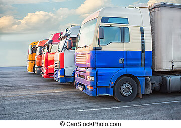 number of big multi-colored trailers on the road