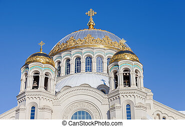 Golden domes with cross of Kronstadt Naval cathedral against...