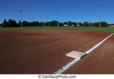 First Base on a Baseball Field - A wide angle shot of a...