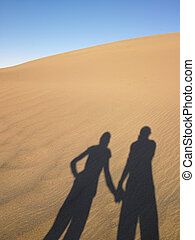Shadow of Two People On Sand Dune - Shadows of two people on...