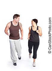 Exercise woman with trainer - A woman running with her...