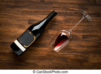 Bottle of wine and glass on old wood background - a bottle...