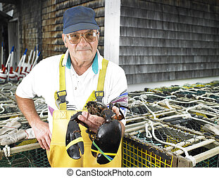 Man Holding Lobster - Man holding lobster and facing the...